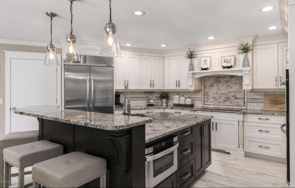 Kitchen Remodel dark cabinets and stainless steel appliances